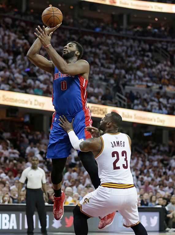 . Detroit Pistons\' Andre Drummond (0) shoots against Cleveland Cavaliers\' LeBron James (23) in the second half in Game 1 of a first-round NBA basketball playoff series, Sunday, April 17, 2016, in Cleveland. The Cavaliers won 106-101. (AP Photo/Tony Dejak)