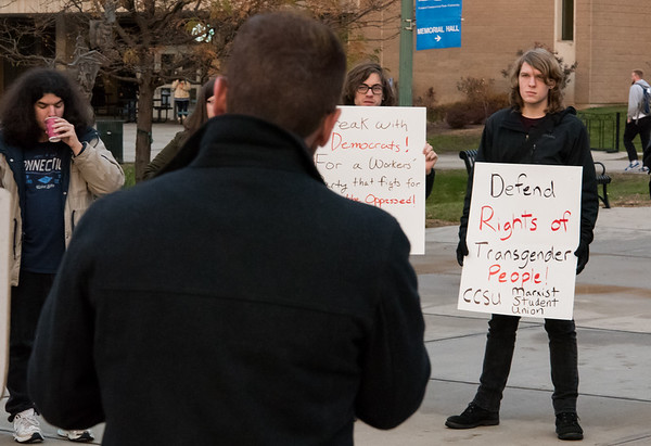 11/20/18 Wesley Bunnell | Staff CCSU held a speak out on Tuesday evening in observance of the Transgender Day of Remembrance followed later with a candlelight vigil. Joseph Donnelly, R, President of the Marxist Student Union holds a sign in support of transgender rights.