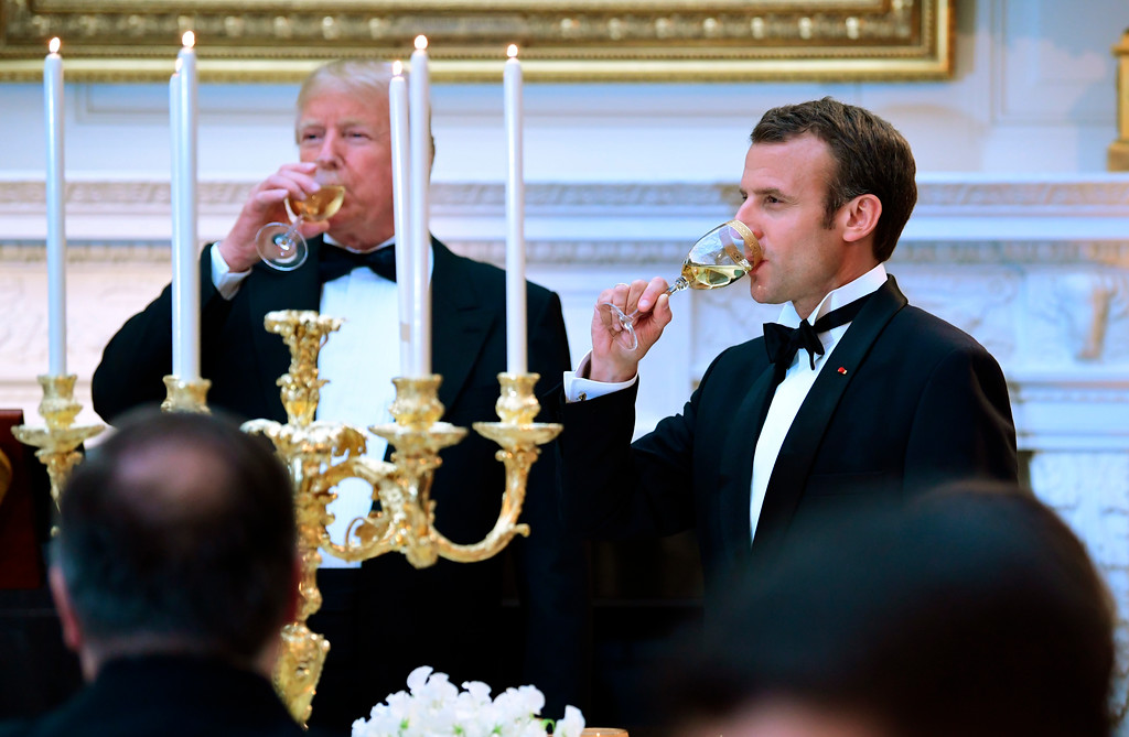 . President Donald Trump and French President Emmanuel Macron toast in the State Dining Room during a State Dinner at the White House in Washington, Tuesday, April 24, 2018. (AP Photo/Susan Walsh)