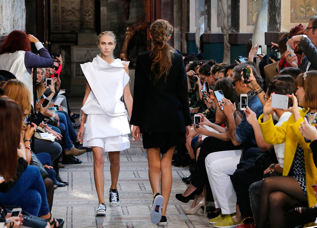 . A model presents a creation as part of South Korean fashion designer Moon Young Hee\'s ready-to-wear Spring/Summer 2014 fashion collection presented in Paris, Tuesday, Sept.24, 2013. (AP Photo/Jacques Brinon)