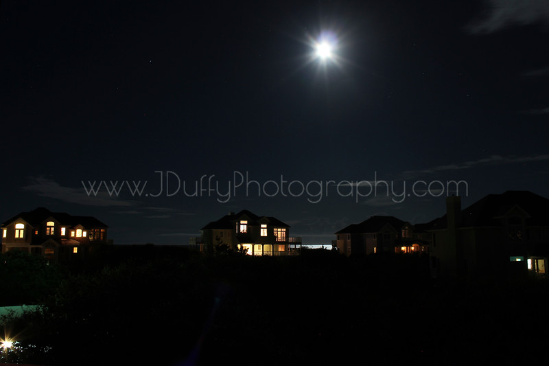 Moon Over Corolla<br /> <br /> This was taken my first night in Corolla during our 2012 Summer trip. I loved the moon's reflection in the Atlantic Ocean between the beachfront houses.