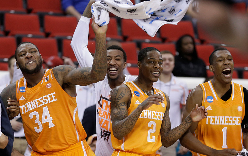 . Tennessee\'s players Jeronne Maymon, Antonio Barton and Josh Richardson, from left, celebrate after the second half of an NCAA college basketball second-round tournament game against Massachusetts, Friday, March 21, 2014, in Raleigh, N.C. Tennessee won 86-67. (AP Photo/Chuck Burton)