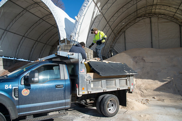 01/17/20 Wesley Bunnell | StaffrrSalt is packed down into a supervisors snow plow truck at the public works department on Friday January 17, 2020.