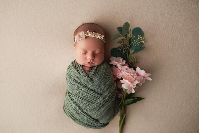 newbornwithflower.jpg