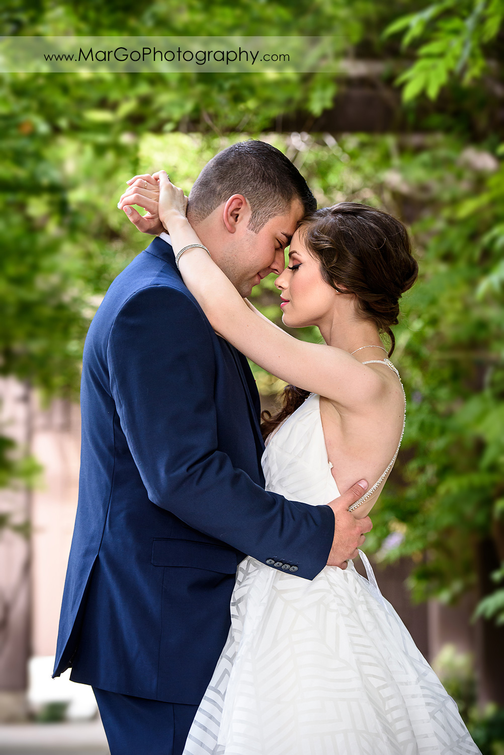 bride and groom touching foreheads at Saratoga Foothill Club