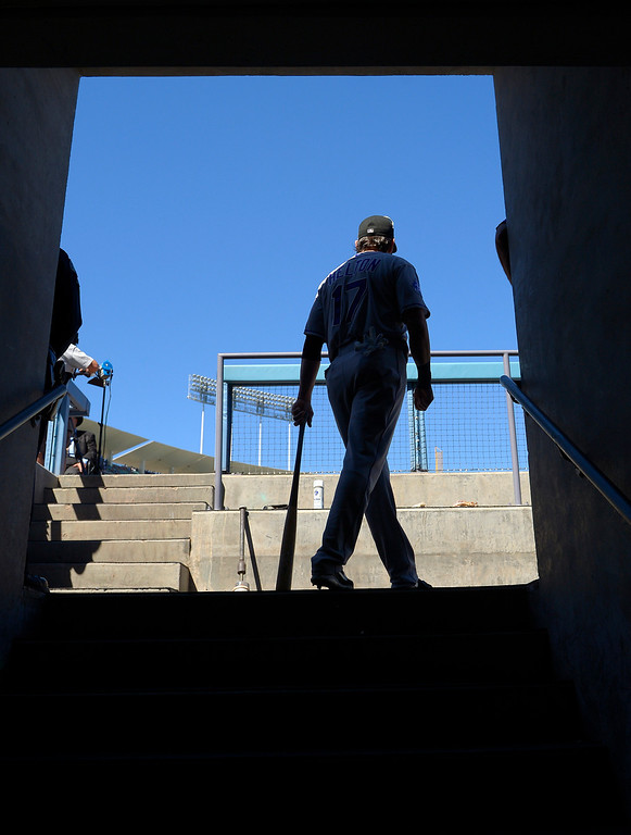 . Colorado Rockies first baseman Todd Helton walks out to the field prior to the Rockies\' baseball game against the Los Angeles Dodgers, Sunday, Sept. 29, 2013, in Los Angeles. Helton is retiring after the season. (AP Photo/Mark J. Terrill)