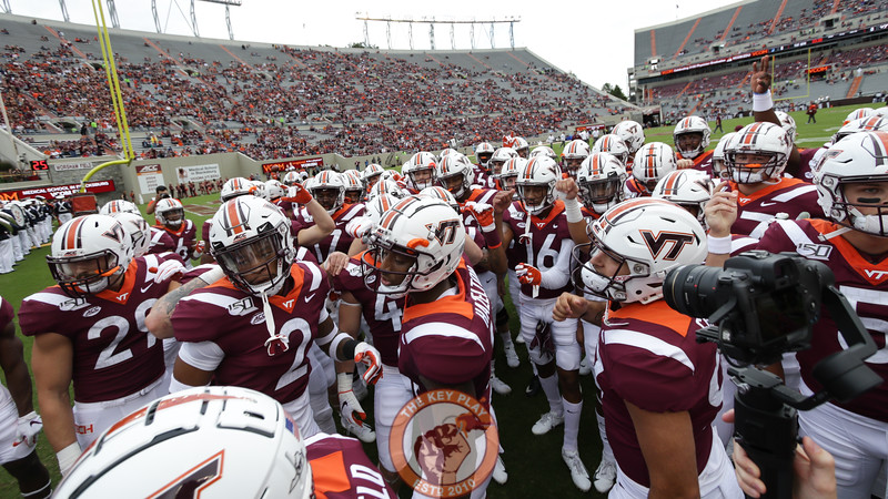 The Hokies huddle in the North endzone during pre-game warmups. (Mark Umansky/TheKeyPlay.com)