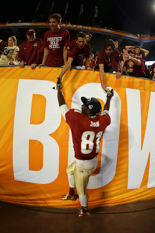 . Kenny Shaw #81 of the Florida State Seminoles celebrates with fans after they won 31-10 against the Northern Illinois Huskies during the Discover Orange Bowl at Sun Life Stadium on January 1, 2013 in Miami Gardens, Florida.  (Photo by Mike Ehrmann/Getty Images)