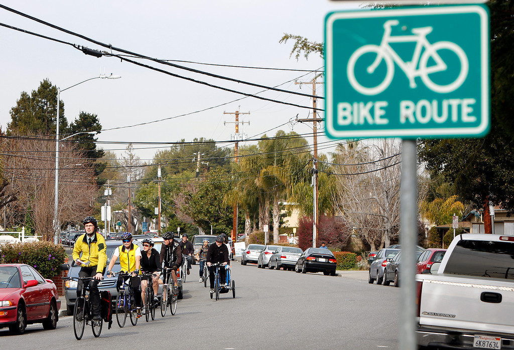 . Members  of Great Streets Rengstorff Park Neighbor Bike Tour ride along Latham Ave., in Mountain View, Calif. on Sat., March 2, 2013. (LiPo Ching/Staff)