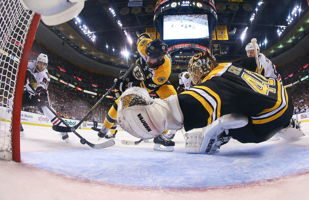 . Boston Bruins defenseman Zdeno Chara (33), of Slovakia, turns the puck from the net in front of Boston Bruins goalie Tuukka Rask, right, of Finland, as Chicago Blackhawks right wing Patrick Kane, left, moves in during the second period in Game 6 of the NHL hockey Stanley Cup Finals Monday, June 24, 2013, in Boston. (AP Photo/Harry How, Pool)