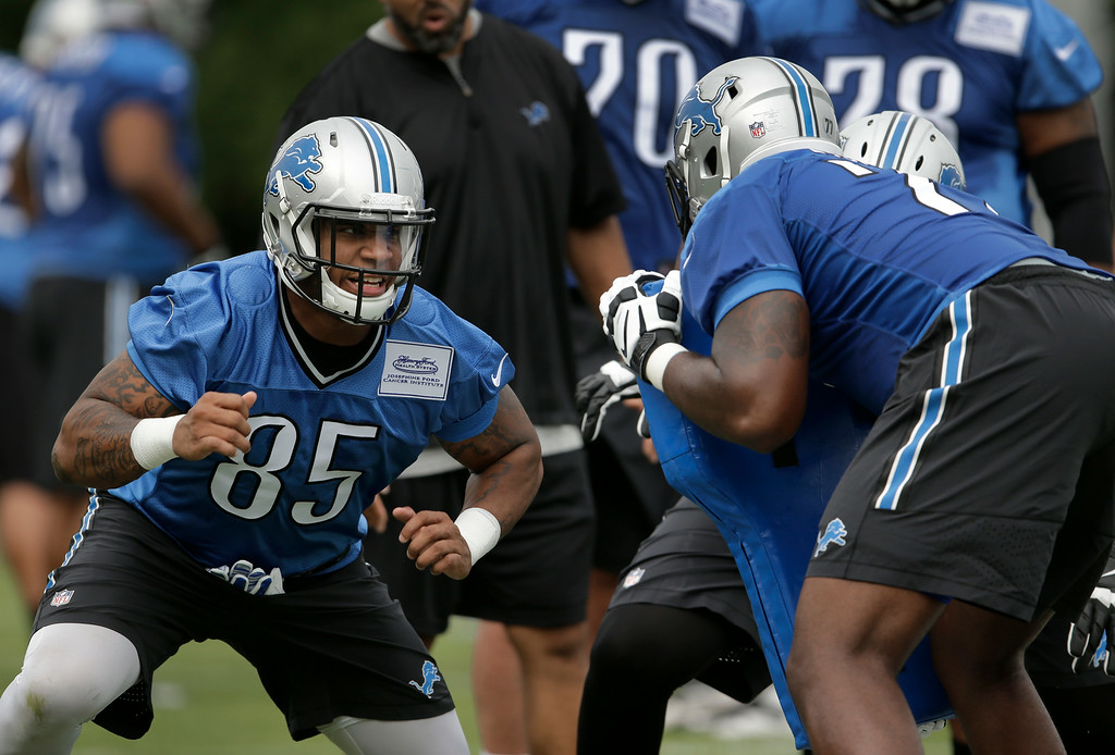 . Detroit Lions tight end Eric Ebron (85) runs a drill during NFL football training camp in Allen Park, Mich., Monday, July 28, 2014. (AP Photo/Paul Sancya)