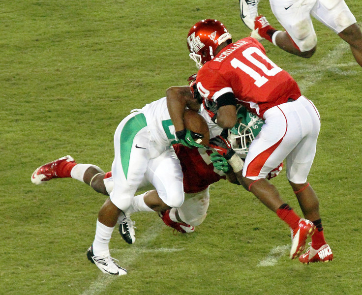 UH's McMillian stops a UNT runner
