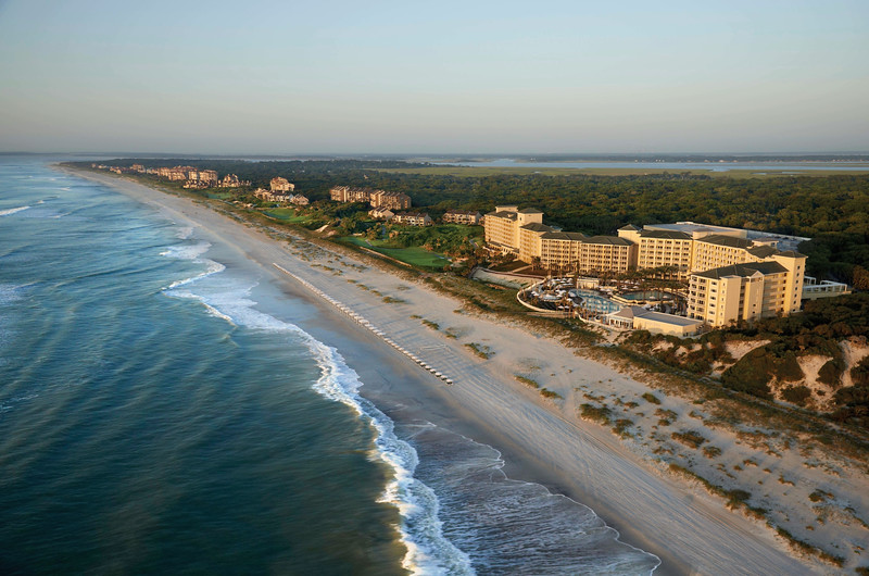 An expansive coastline with a hotel complex on the shore