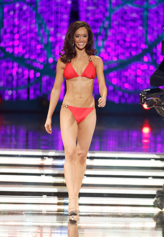 . Miss Texas Danae Couch competes in the swimsuit portion of the Miss America 2013 pageant on Saturday, Jan. 12, 2013, in Las Vegas. (AP Photo/Isaac Brekken)