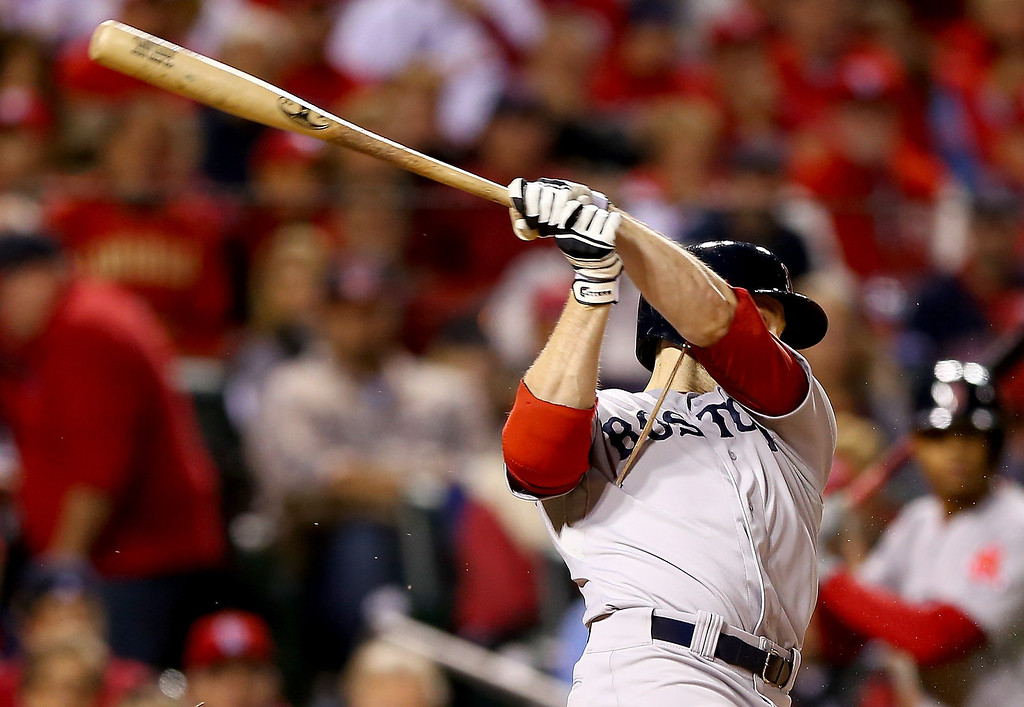 . Daniel Nava #29 of the Boston Red Sox breaks his bat in the fourth inning against the St. Louis Cardinals during Game Five of the 2013 World Series at Busch Stadium on October 28, 2013 in St Louis, Missouri.  (Photo by Elsa/Getty Images)