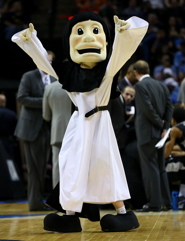 . The Providence Friars mascot is shown during a timeout of the Friars game against the North Carolina Tar Heels during the second round of the 2014 NCAA Men\'s Basketball Tournament at AT&T Center on March 21, 2014 in San Antonio, Texas.  (Photo by Ronald Martinez/Getty Images)