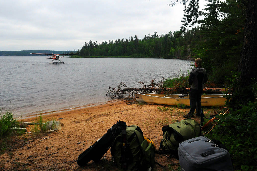 . Bags packed, Safranski awaits a floatplane to be taken out of Woodland Caribou Provincial Park July 6, 2013. Safranski and Orrick decided on a paddle-in/fly-out option for the wilderness park, which allows aircraft to land on certain lakes.