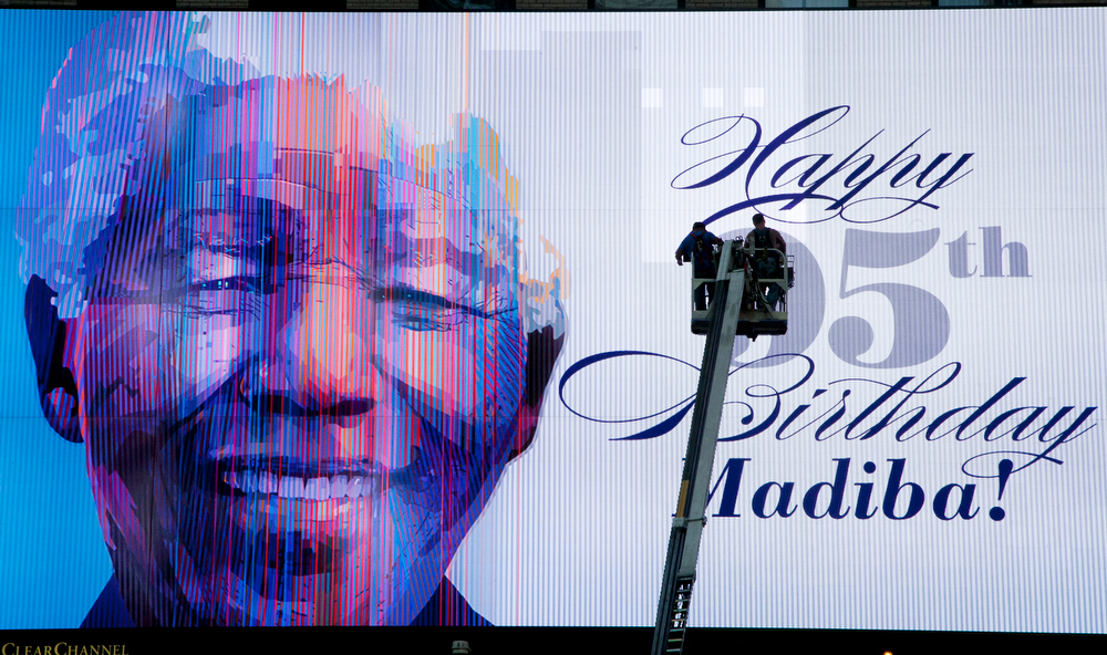 . An electronic billboard announces Nelson Mandela\'s 95th birthday in New York\'s Times Square, Thursday, July 18, 2013. South Africa celebrated Nelson Mandela\'s 95th birthday on Thursday, a milestone capped by news that the former president\'s health was improving after fears that he was close to death during ongoing hospital treatment. (AP Photo/Mark Lennihan)