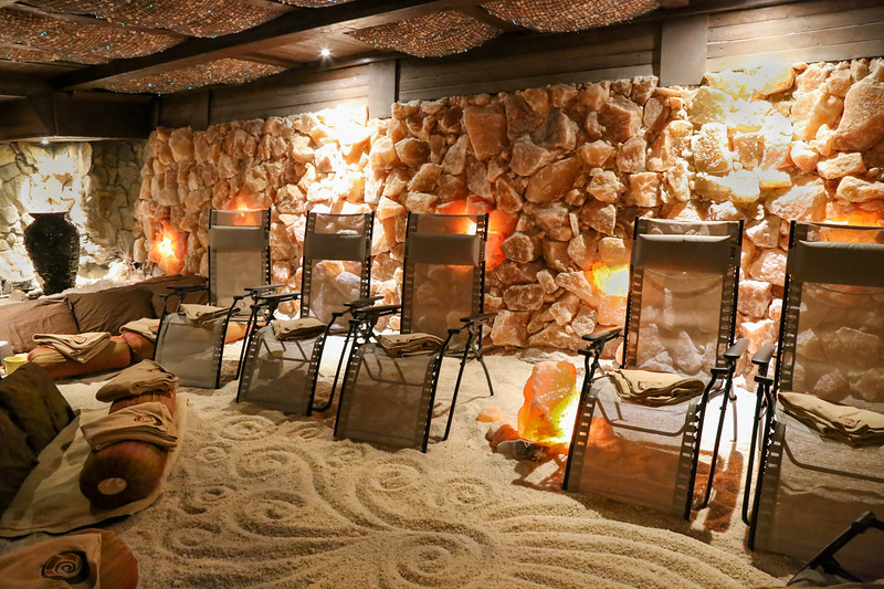 a set of chairs on sand in a salt cave.