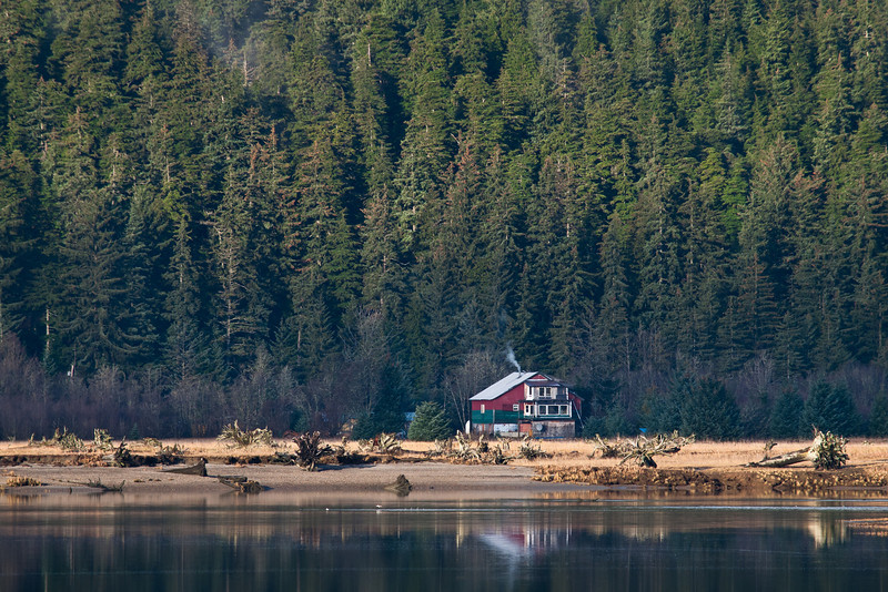 The ramshackle house on the other side of the Mendenhall River.
