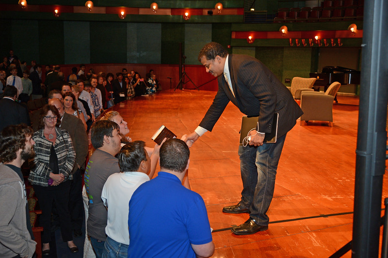 dr-neil-degrasse-tyson-shakes-hands-with-members-of-the-audience-following-his-talk-during-the-spring-2014-distinguished-speaker-series_13583303094_o.jpg