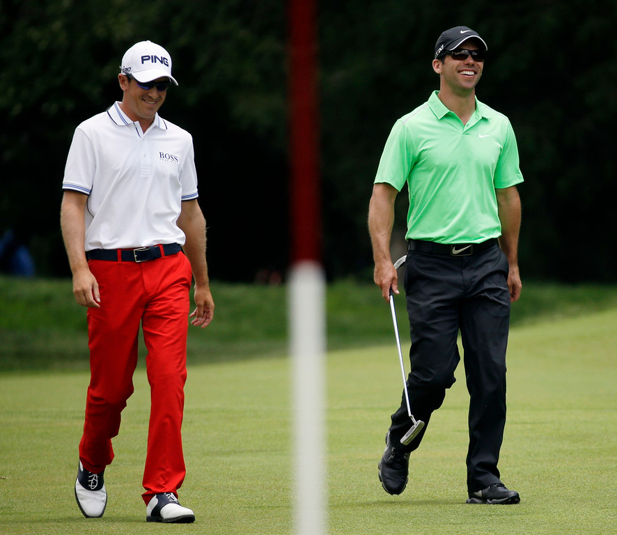 . Paul Casey, right, of England, and Scott Langley walk to the first green during the third round of the U.S. Open golf tournament at Merion Golf Club, Saturday, June 15, 2013, in Ardmore, Pa. (AP Photo/Morry Gash)