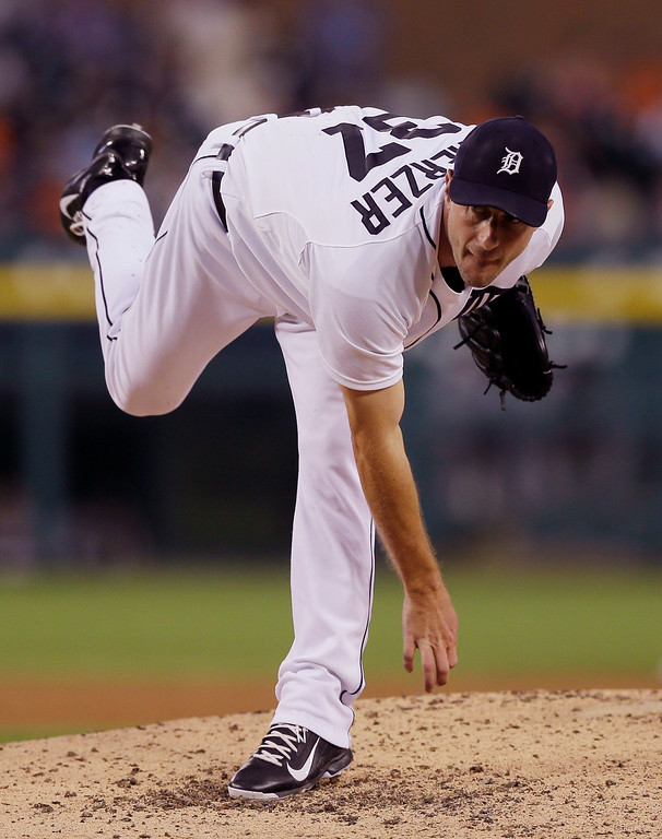 . Detroit Tigers starting pitcher Max Scherzer follows through during the fifth inning of a baseball game against the Chicago White Sox, Wednesday, July 30, 2014 in Detroit. (AP Photo/Carlos Osorio)
