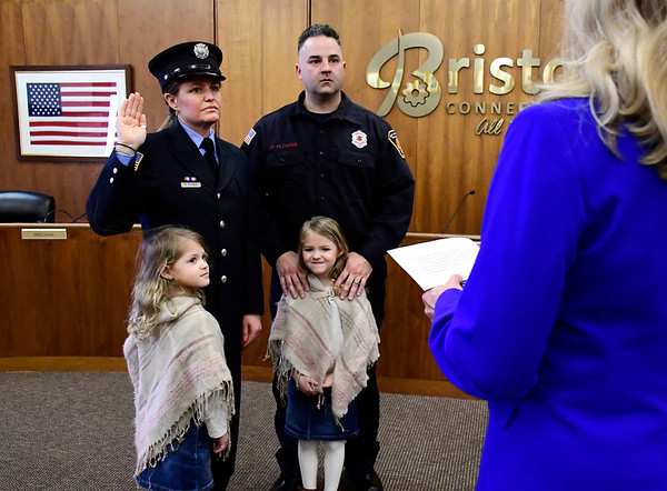 3/13/2020 Mike Orazzi | Staff Bristol firefighter Adrienne Plourde and her husband Brian and their daughters Cameron and Olivia, 5 1/2 during her promotion ceremony to lieutenant at Bristol City Hall on Friday afternoon.