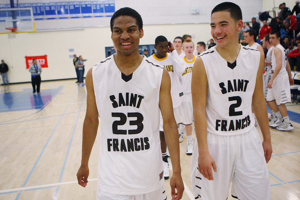 . St. Francis\' Khalil Johnson, left, and Brycen Carbonel are all smiles after their victory over Willow Glen during the CCS Division II boys basketball finals at Santa Clara High School in Santa Clara, Calif. on Friday, March 1, 2013. The Saint Francis Lancers beat the Willow Glen Rams, 56-46. (Jim Gensheimer/Staff)