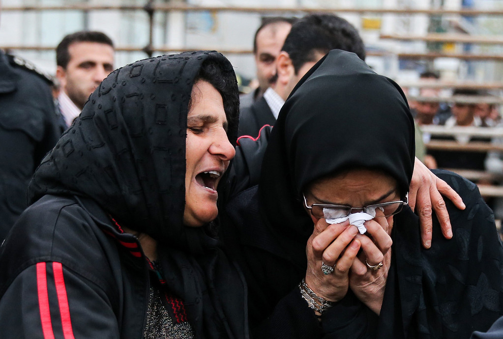 . The mother of an Iranian man Balal (L), who killed an Iranian youth Abdolah Hosseinzadeh in a street fight with a knife in 2007, cries with the mother of Abdolah Hosseinzadeh after she forgave Balal, giving him an emotional slap prior to removing the noose around his neck in the gallows during his execution ceremony in the northern city of Nowshahr on April 15, 2014. AFP PHOTO/ARASH KHAMOOSHI/AFP/Getty Images