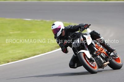 KTM Naked with White Helmet