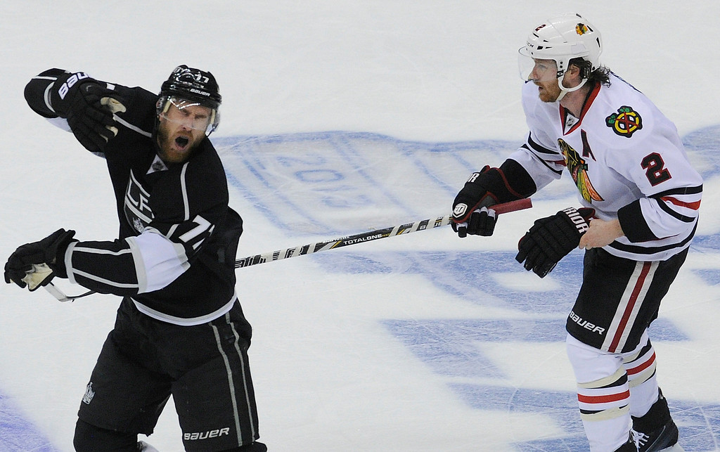 ". Kings#77 Jeff Carter reacts after getting a stick in the face from Blackhawks#2 Duncan Keith in the 2nd period. Keith would end up in the penalty box as a result of the ""High Sticking.\"" The Kings played the Chicago Blackhawks in the 3rd game of the Western Conference Finals. Los Angeles, CA 6/4/2013(John McCoy/LA Daily News4"