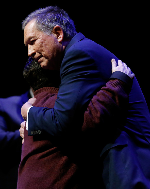 . Ohio Gov. John Kasich, right, hugs Governor\'s Courage Award recipient Chris Hole, a nurse who helped save lives after the Las Vegas shooting, during the Ohio State of the State address in the Fritsche Theater at Otterbein University in Westerville, Ohio, Tuesday, March 6, 2018. (AP Photo/Paul Vernon)