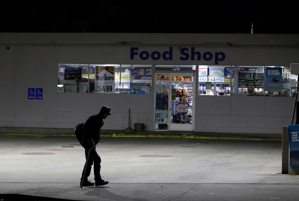 . A man walks past an evacuated gas station after an evacuation order under threat from spillage from the Oroville Dam in Oroville, Calif., Monday, Feb. 13, 2017. Helicopters dropped giant rock-filled sandbags into place Monday to shore up the California reservoir that had threatened to breach its banks and unleash a 30-foot wall of water, but officials said the evacuation order would stay in place until they are sure it\'s safe to return home. (AP Photo/Marcio Jose Sanchez)