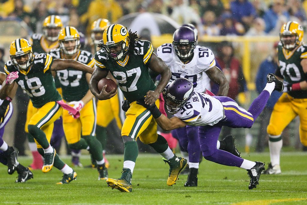 . GREEN BAY, WI - OCTOBER 2: Eddie Lacy #27 of the Green Bay Packers carries the football against Robert Blanton #36 of the Minnesota Vikings in the first half of the NFL game on October 02, 2014 at Lambeau Field in Green Bay, Wisconsin. (Photo by John Konstantaras/Getty Images)