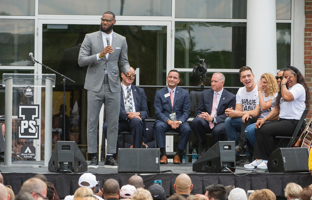 . LeBron James speaks and gets a laugh from his mother, Gloria, right, at the opening ceremony for the I Promise School in Akron, Ohio, Monday, July 30, 2018. The I Promise School is supported by the The LeBron James Family Foundation and is run by the Akron Public Schools. (AP Photo/Phil Long)