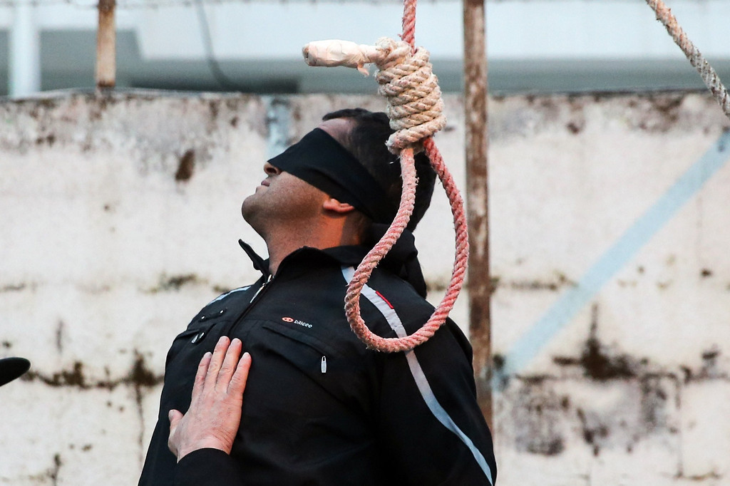 . Balal, who killed Iranian youth Abdolah Hosseinzadeh in a street fight with a knife in 2007, is pictured blindfolded next to a noose during his execution ceremony in the northern city of Nowshahr on April 15, 2014.  AFP PHOTO/ARASH KHAMOOSHI/AFP/Getty Images