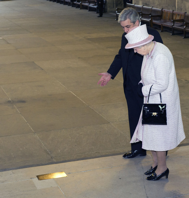 . Queen Elizabeth II, accompanied by Speaker of the House of Commons, John Bercow, looks at the plaque dedicated to Nelson Mandela as she visits the Palace of Westminster to view the Diamond Jubilee Window which has been installed in the Great Window of Westminster Hall on December 6, 2013 in London, England. (Photo by Arthur Edwards-WPA Pool/Getty Images)