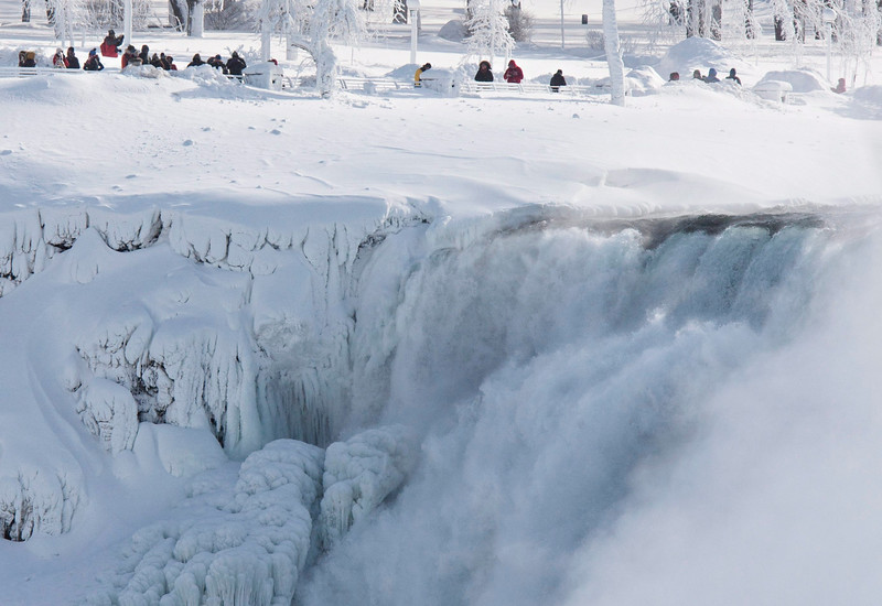. Niagara Falls State Park visitors look over masses of ice formed around the American Falls, photographed from across the Niagara River in Niagara Falls, Ontario, Canada, Thursday, Feb. 19, 2015. (AP Photo/The Canadian Press,Aaron Lynett)