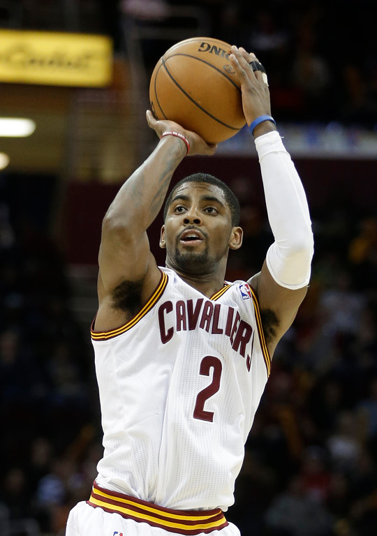 . Cleveland Cavaliers\' Kyrie Irving shoots a 3-point shot against the New York Knicks in there fourth quarter of an NBA basketball game Tuesday, Dec. 10, 2013, in Cleveland. (AP Photo/Mark Duncan)