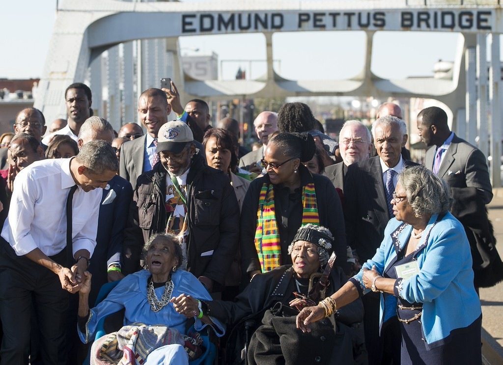 ". US President Barack Obama(L) speaks to Amelia Boynton Robinson (2L), one of the original marchers,  after leading a walk across the Edmund Pettus Bridge to mark the 50th Anniversary of the Selma to Montgomery civil rights marches in Selma, Alabama, March 7, 2015. US President Barack Obama rallied a new generation of Americans to the spirit of the civil rights struggle, warning their march for freedom ""is not yet finished.\"" In a forceful speech in Selma, Alabama on the 50th anniversary of the brutal repression of a peaceful protest, America\'s first black president denounced new attempts to restrict voting rights. AFP PHOTO/ SAUL LOEB/AFP/Getty Images"