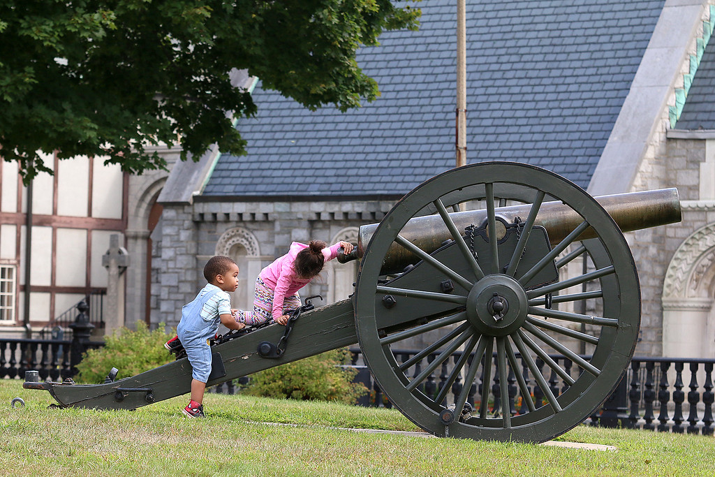 . Harvey Garcia Grow, 2, and Chageira Dailys, 4, play on the cannons in Monument Park on Main Street in Fitchburg on Thursday morning. SENTINEL & ENTERPRISE/JOHN LOVE