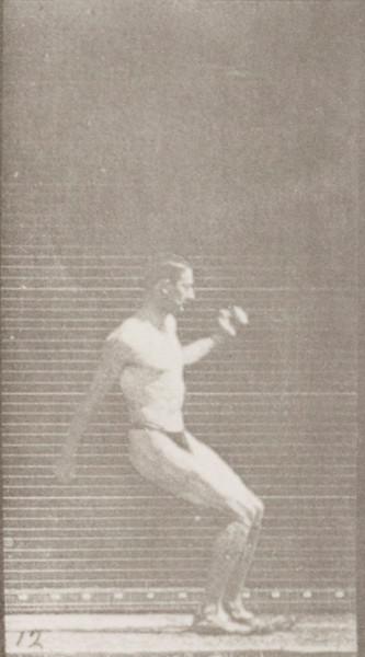 Man in pelvis cloth hurdling horizontal pole