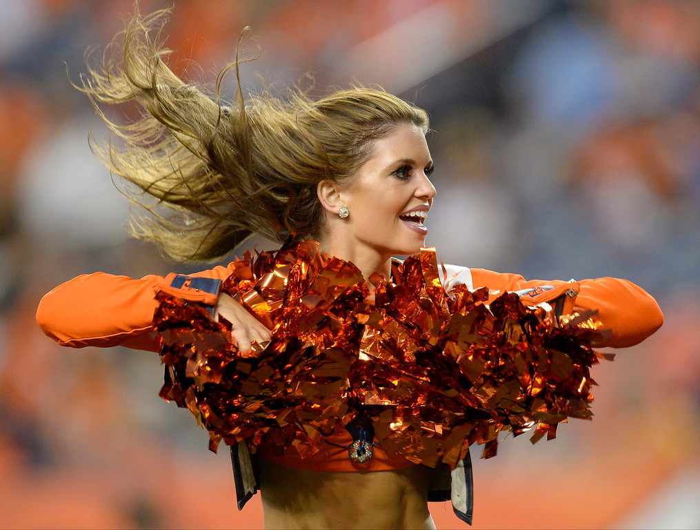 . A Denver Broncos cheerleader works the crowd during the first half on August 29, 2013 at Sports Authority Field at Mile High. The Denver Broncos hosted the Arizona Cardinals in the final game of the preseason. (Photo by John Leyba/The Denver Post)