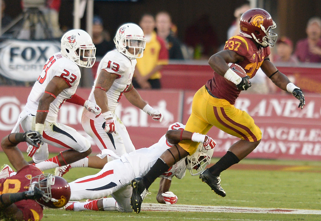 . Javorius Allen runs for yards in the 3rd quarter. USC defeated Fresno State 52-13 at the Los Angeles Memorial Coliseum. Los Angeles, CA. 8/30/2014(Photo by John McCoy Daily News