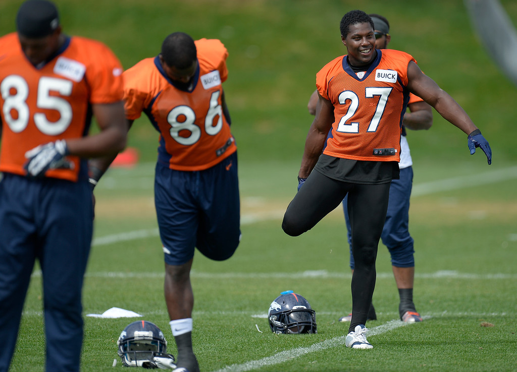 . Denver Broncos running back Knowshon Moreno (27) stretches during practice August 23, 2013 at Dove Valley (Photo by John Leyba/The Denver Post)