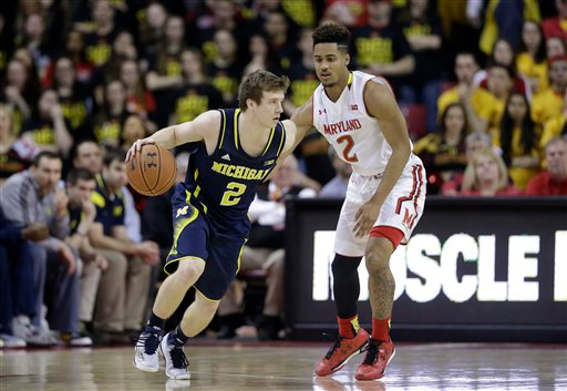. Michigan guard Spike Albrecht, left, drives around Maryland guard Melo Trimble in the second half of an NCAA college basketball game, Saturday, Feb. 28, 2015, in College Park, Md. (AP Photo/Patrick Semansky)