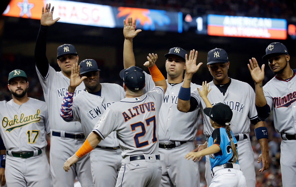 . American League\'s Houston Astros Jose Altuve (27) is greeted by his teammates during the MLB baseball All-Star Game, Tuesday, July 11, 2017, in Miami. (AP Photo/Lynne Sladky)