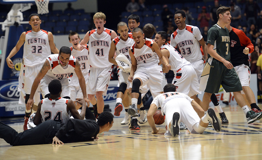 . Tustin players run on to the court as Royal\'s Justin Anderson #3 walks off during their CIF-SS Division III-AAA Boys Basketball Championship at the Anaheim Convention Center Thursday, February 28, 2013. Tustin beat Royal 49-32.  (Hans Gutknecht/Staff Photograpehr)