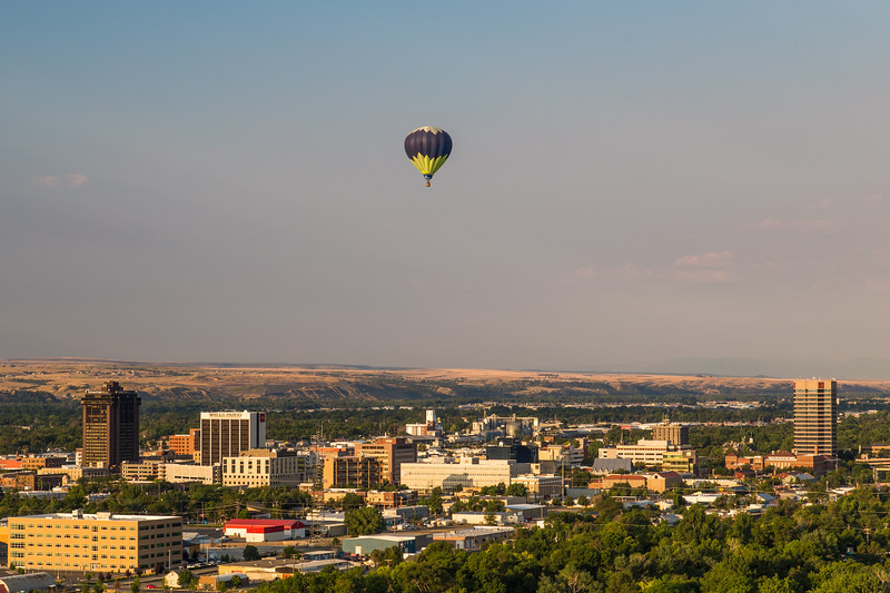Hot air balloon passing over downtown BIllings